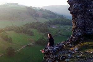 Woman sitting at Llangollen Castell Dinas Bran